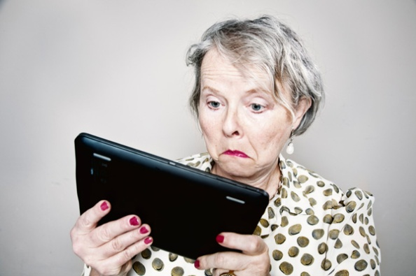 senior-woman-confused-by-tablet-computer(sheknows.com)